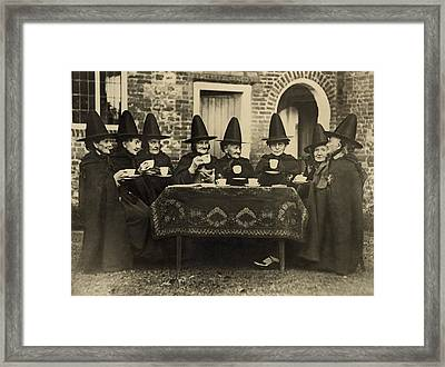 Eight Women In High Hats Having Tea Framed Print by Everett