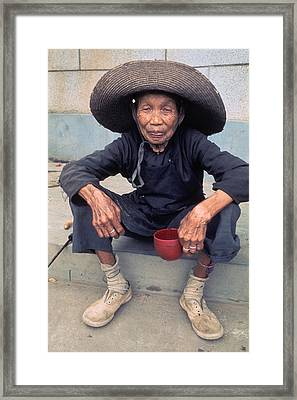 Elderly Begger Woman In China Framed Print by Carl Purcell