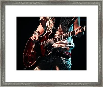Framed Print featuring the photograph Electric Rock by Cameron Wood