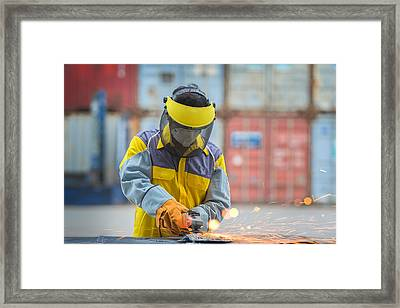 Electric Wheel Grinding  Framed Print by Anek Suwannaphoom