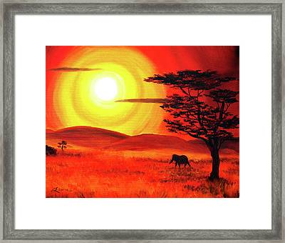 Elephant In A Bright Sunset Framed Print
