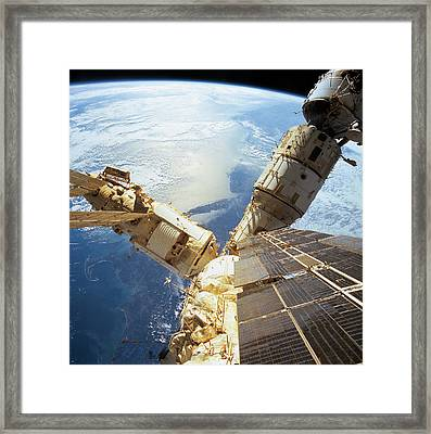 Elevated View Of A Space Station In Orbit Framed Print by Stockbyte