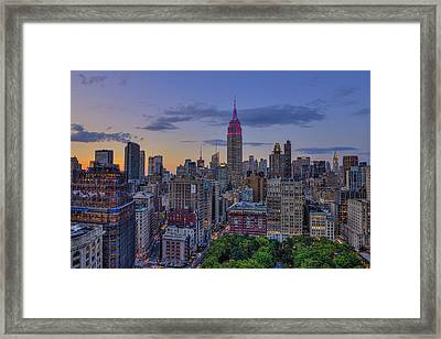 Empire State Building At Sunset Framed Print by F. M. Kearney