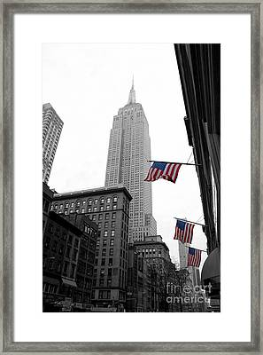 Empire State Building In The Mist Framed Print by John Farnan