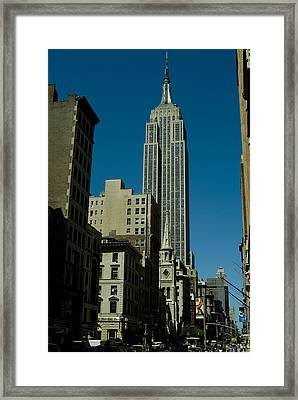 Empire State Building Seen From Street Framed Print by Todd Gipstein