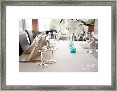 Empty Wineglasses And White Lilium Lily Flowers  Framed Print