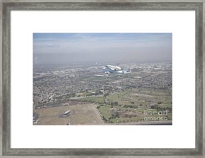 Endeavor Flying Over The Goodyear Blimp Framed Print