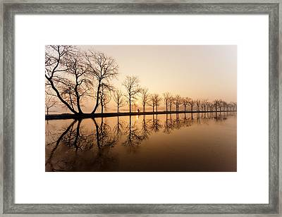 Endlessness - Silhouette Reflected On An Early Morning Sunrise Framed Print