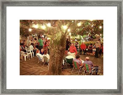 Enjoying A Night Out Framed Print by Gaspar Avila