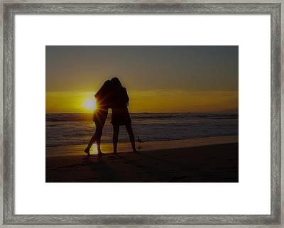 Enjoying The Sunset Framed Print by Ernie Echols