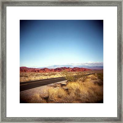 Entering The Valley Of Fire Framed Print by Lori Andrews