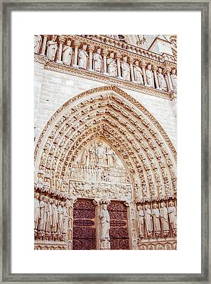 Entrance To Notre Dame Cathedral Framed Print