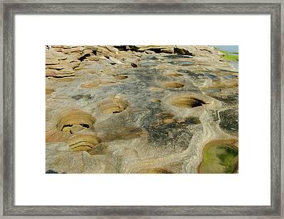 Eroded Beach Rocks Framed Print by David Campione