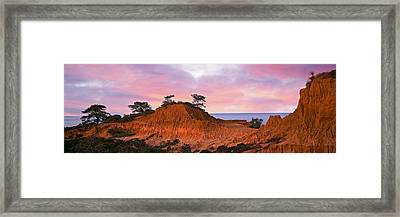 Eroded Hill With Ocean Framed Print