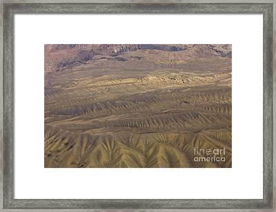 Eroded Hills Framed Print by Tim Grams