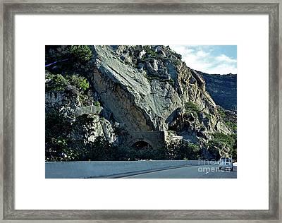 Eroding Hillside And Tunnel Framed Print