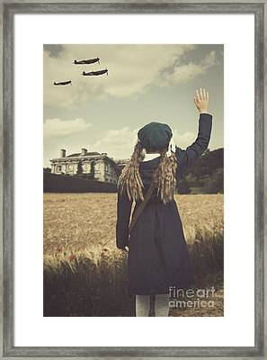 Evacuee Girl Waving Framed Print by Amanda Elwell
