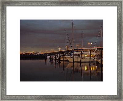 Evening At The Twin Dolphin Marina Framed Print