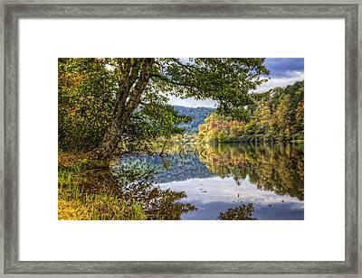 Evening Reflections Framed Print by Debra and Dave Vanderlaan