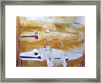 Evolution Of A Wind-up Crocodile Framed Print