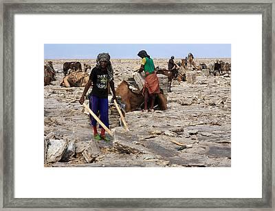 Excavating The Salt Blocks Framed Print by Aidan Moran