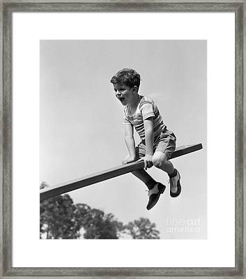 Excited Boy On Seesaw, C.1930-40s Framed Print by H. Armstrong Roberts/ClassicStock
