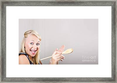 Excited Cooking Woman Pointing To Copyspace Framed Print by Jorgo Photography - Wall Art Gallery
