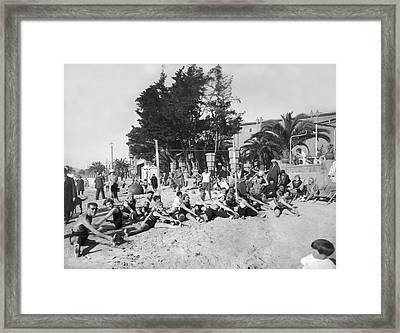 Exercises On The Beach Framed Print