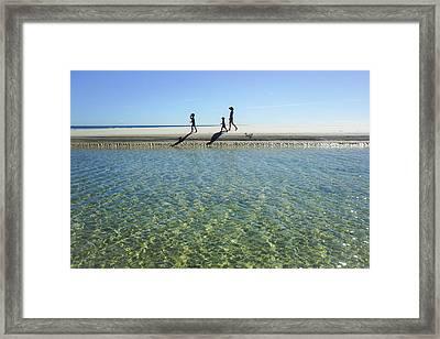 Exploring A Tidal Beach Lagoon Framed Print