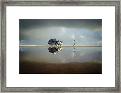 Exploring The Beach On A Rainy Day Framed Print