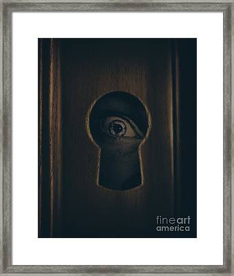 Eye Looking Through Door Keyhole Framed Print