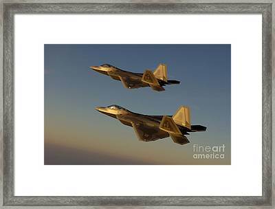 F-22a Raptors Fly Over Langley Air Framed Print by Stocktrek Images