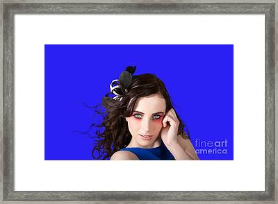Face Of A Female Beauty With Red Eye Make Up Framed Print