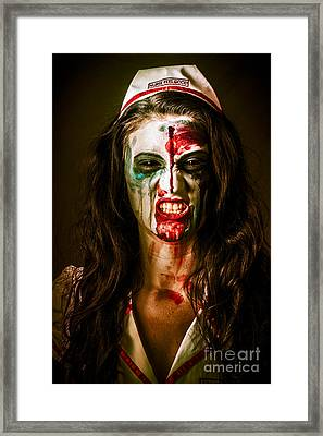 Face Of A Scary Woman In A Horror Nurse Costume Framed Print by Jorgo Photography - Wall Art Gallery