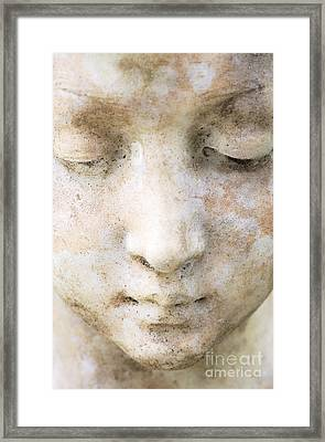 Face Of Stone Framed Print by Neil Overy