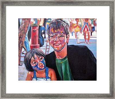 Face-painter Framed Print by Michael Gaudet