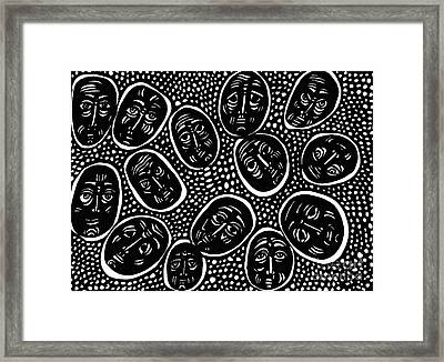 Faces In Stone Framed Print by Sarah Loft