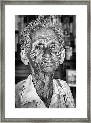 Faces Of Cuba The Woman In Need Framed Print by Wayne Moran