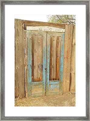 Faded Blue Door Framed Print by Jeff Swan
