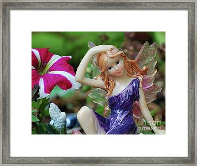 Framed Print featuring the photograph Fairy In Flowerbed by Lila Fisher-Wenzel