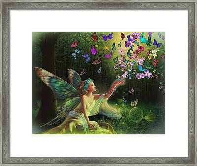 Fairy Of The Butterflies Framed Print by Edelberto Cabrera