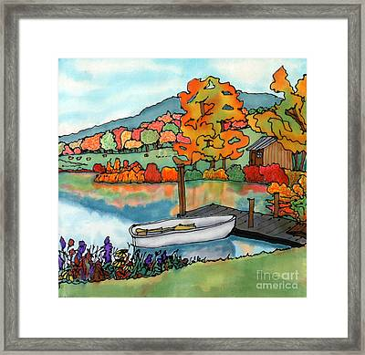 Fall Boat And Dock Framed Print by Linda Marcille