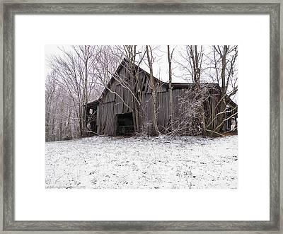 Falling Barn Framed Print