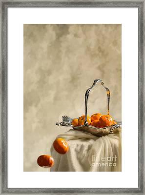 Falling Oranges Framed Print by Amanda Elwell
