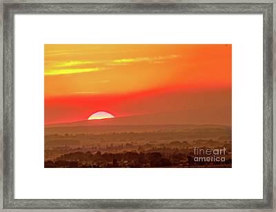 Falling Sun Framed Print