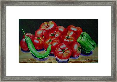 Falling Tomato Framed Print by Ron Sylvia