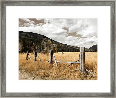 Framed Print featuring the photograph Fallowfield Weathered Fence Rocky Mountain National Park Dramatic Sky by John Stephens