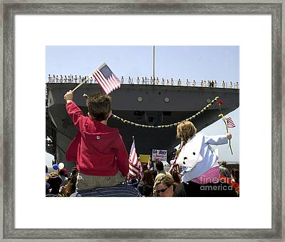 Family And Friends Wait To Welcome Home Framed Print