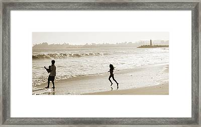Family At Play On Beach Framed Print by Marilyn Hunt