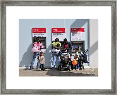 Family Budgeting At The Cash Machine Framed Print by Andy Smy